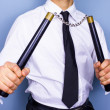 Businessman with nunchaku nunchucks — Stock Photo