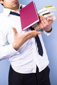 Tired business student dropping books — Stock Photo