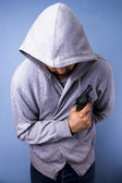 Hooded thug with gun — Stock Photo