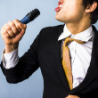 Businessman singing karaoke — Stock Photo