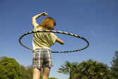 Young woman with hula hoop in the park — Stock Photo