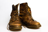 Dirty old brown boots — Stock Photo