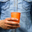 Closeup on man holding paper cup — Stock Photo