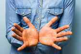 Blue collar worker showing his palms — Stock Photo