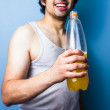 Young man drinking energy drink after a sweaty workout — Stock Photo #28218573