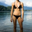 Stock Photo: Womin bikini relaxing in mountain lake