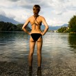 Stock Photo: Sexy womin swimsuit admiring mountain lake
