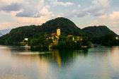 Church on an island in mountain lake — Stock Photo