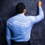 Man drawing on blackboard — Stock Photo #28795175