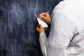 Man taking notes by blackboard — Stock Photo