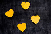 Heart shaped notes on blackboard — Stock Photo