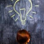 Redhead businesswoman having a bright idea — Stock Photo #29178537
