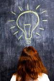 Redhead woman having a bright idea — Stock Photo