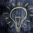 Chalk drawing of lightbulb on blackboard — Stock Photo #29181233