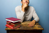 Student with books is thinking — Stock Photo