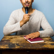 Man with book is speaking into microphone — Stock Photo #29722127