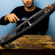 Worker fixing bicycle tyre — Stock Photo