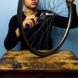 Worker fixing bicycle tyre — Stock Photo #29973909