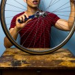 Man fixing bicycle tyre — Stock Photo