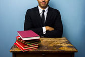 Young lawyer with stack of books — Stock Photo
