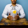 Man holding his piggy bank — Stock Photo