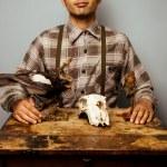 Hunter with daxidermy diorama — Stock Photo