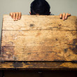 Man looking inside old school desk — Stock Photo
