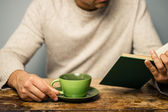 Man is reading and having coffee — Stock Photo