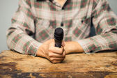 Journalist with microphone — Stock Photo