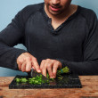 Stock Photo: Man chopping herbs