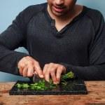 Man chopping herbs — Stock Photo