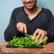 Man chopping lettuce — Stock Photo