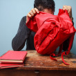 Student trying to find something in his bag — Stock Photo #30031805