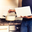 Man following recipe on his laptop computer — Stock Photo #30425897