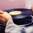 Hands placing record on turntable — Stock Photo