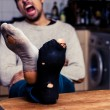 Man with worn out socks is tired — Stockfoto