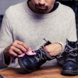Man is polishing his boots — Stock fotografie