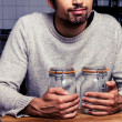 Man with two jam jars — Stock Photo