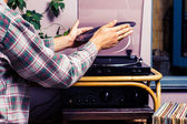 Man placing record on turntable — Stock Photo