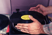 Hands placing LP on turntable — Stock Photo