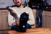 Man with worn out socks is tired — Stock Photo