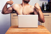 Naked man trying to impress during webcam chat — Stock Photo
