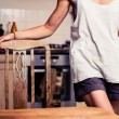 Young woman standing in her kitchen — Stock Photo