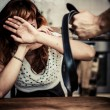 Woman in fear of domestic violence — Stockfoto