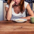Woman doesn't want to eat her cereal — Stock Photo