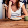 Young woman hates cereal — Stock Photo