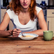 Woman eating cereal for breakfast — Stock Photo