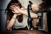 Woman in fear of domestic violence — Stock Photo