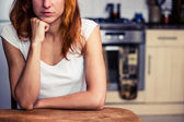 Woman is thinking in her kitchen — Stock Photo