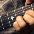 Close up on hand playing guitar — Stock Photo